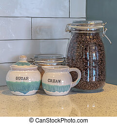 Square frame Coffee and sugar in glass storage bottles