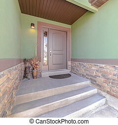 Square frame Front porch and door of traditional green home