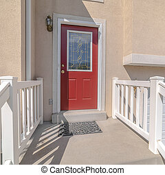 Square frame Red front door and steps of traditional home