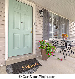 Square Front door of suburban home with welcome mat