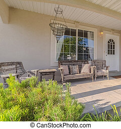 Square Front porch and garden of a traditional home
