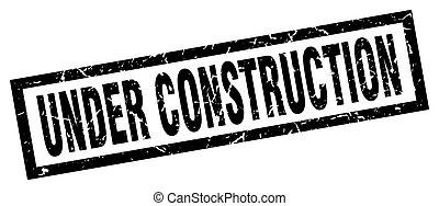 square grunge black under construction stamp