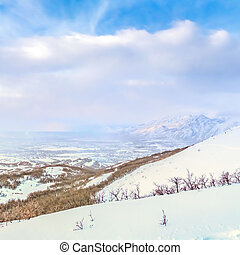 Square Panoramic view of a stunning snowy mountain against vibrant sky with clouds