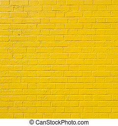square part of yellow painted brick wall