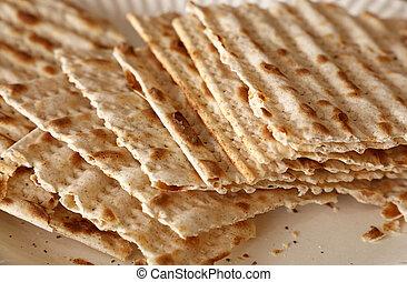 Square pieces of matzo flatbread crackers