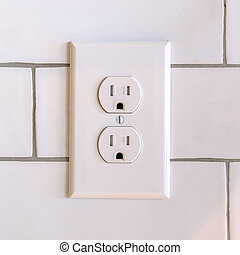 Square Power outlet on white wall in home