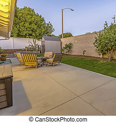 Spacious patio at the backyard of a home with a seating and dining area