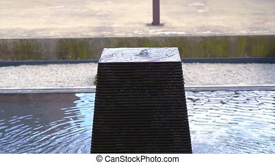 square stone shaped water fountain