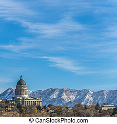 Square The majestic Utah State Capital Building towering over houses in Salt Lake City