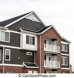 Square Three story residential house in America day light - ...
