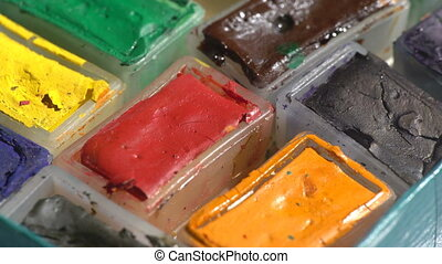Square watercolor paints boxes - Macro of old used...