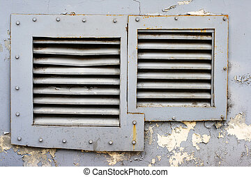 square windows with iron grating