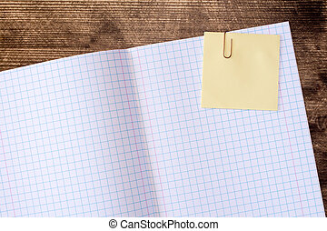 Squared exercise book with sticky note