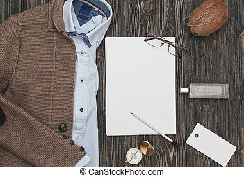 Squared flat lay of mens casual clothes on black wooden background. Top view