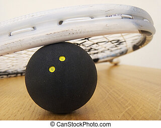 Squash! - A Squash racket leaning on a Squash ball