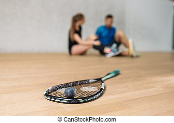 Squash game concept, racket with ball