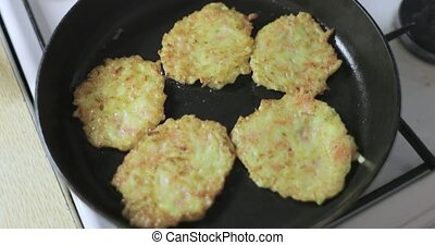 squash potatoes fry in a pan.