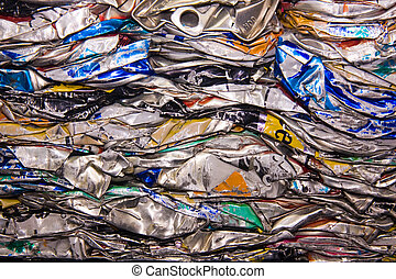 squashed cans - a close up of metal drink cans squashed for...