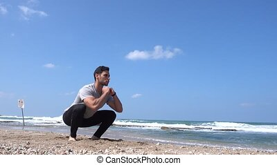 Squat exercise on the beach 4k - Squat exercise on the beach
