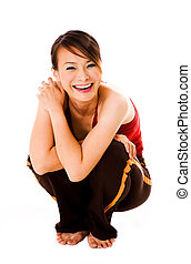 squating and happy - woman squatting and laughing happily