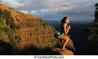 Squats - woman doing squats exercises in amazing landscape ...