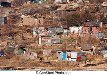 squatter camp africa - poor squatter camp in africa with...