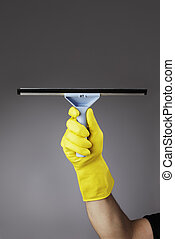 Squeegee - A gloved hand holding a squeegee