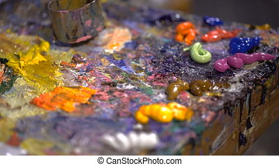 Squeezed out on a palette oil picturesque colors from an...
