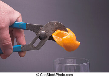 Squeezing an Orange - Fresh squeezed orange juice.
