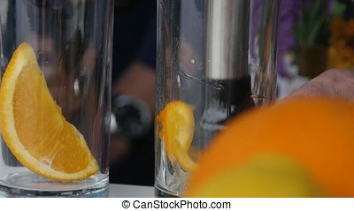 Squeezing orange juice pouring into glass 4K