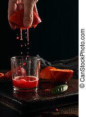 Squeezing the juice of blood oranges