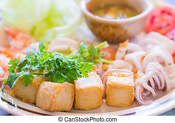 squid shrimp tofu boiled with vegetable on dish