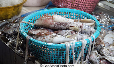 Squids in a basket in a market, Philippines.
