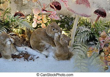 Squirrels and wood stylized Christmas tree with decorations with boken