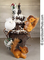 Squirrels figurines and snowy birdhouse