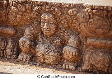 Sri Lanka, Anuradhapura. Mythological character on stone wall of temple