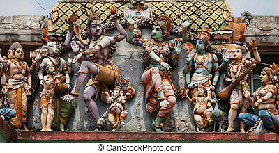 Decoration on the Hindu temple wall. Figures of dancing people