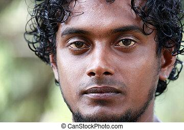 Sri Lanka the man - Portrait young men on a green...