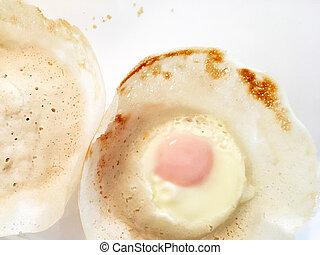 Sri Lankan cuisine - Egg hoppers - Hoppers with egg, a ...