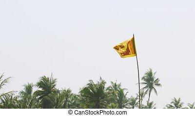 Sri Lankan National Flag Waving over a Beach. 4k footage - ...