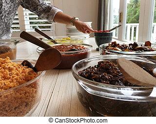 Sri Lankan woman serve home made cuisine on a table. Food ...
