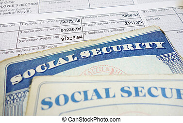 SS and wages - Closeup of Social Security cards and W2 wage...