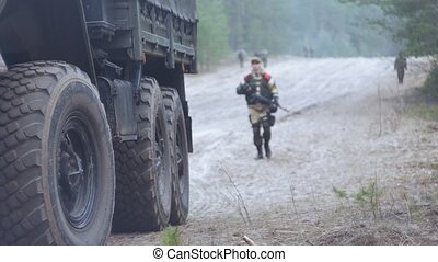 Soldiers in camouflage with combat weapons in the forest...