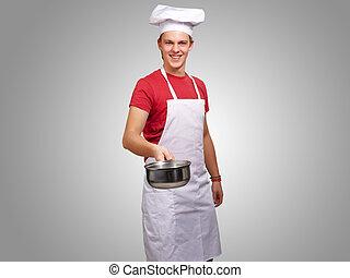 stående, av, a, kock, holdingen, panorera