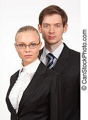stående, av, allvarlig, ung, affärsverksamhet kvinna, och, affärsman