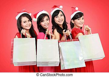 stående, av, lycklig, roliga folk, med, jul, jultomten hatt, holdingen, gåva boxar