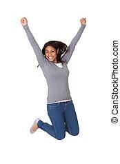 stående, av, spänd, ung kvinna, hoppning