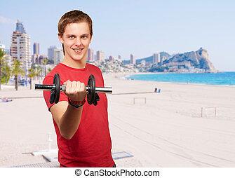 stående, av, ung man, med, vikter, in, mot, a, strand
