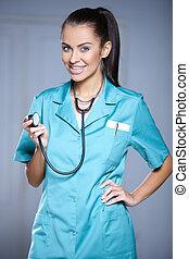 stående, av, vacker, kvinna läkare