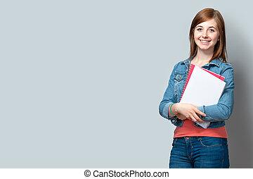 stående, tonårig, böcker, flicka